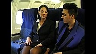 Brunette beauty wearing stewardess uniform gets...